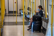 A member of flight crew - Passenger numbers are down dramatically on the tube and buses as people heed government guidance. Those who do travel obey the signs that are everywhere and many wear masks. The 'lockdown' continues for the Coronavirus (Covid 19) outbreak in London.