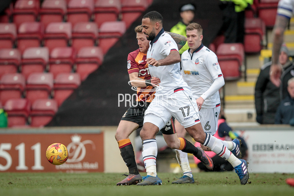 Liam Trotter (Bolton Wanderers) runs with the ball under pressure during the EFL Sky Bet League 1 match between Bradford City and Bolton Wanderers at the Coral Windows Stadium, Bradford, England on 18 February 2017. Photo by Mark P Doherty.
