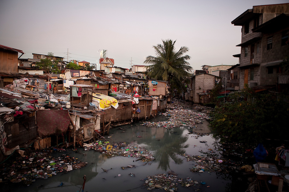 The slum areas in Manila city tend to follow the flow of the canals through the city, Philippines.