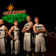 "UVU senior basketball players, Holton Hunsaker, Ben Aird, Keawe Enos and Taylor Brown pose for a portrait at the iconic ""Welcome to Las Vegas"" sign while at the WAC tournament in Las Vegas, Nevada, Thursday March 13,  2014. (August Miller)"