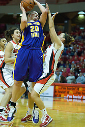 01 January 2011: Lizzie Boeck knocks away Amanda Clifton as she takes a shot during an NCAA Women's basketball game between the Northern Iowa Panthers and the Illinois State Redbirds at Redbird Arena in Normal Illinois.