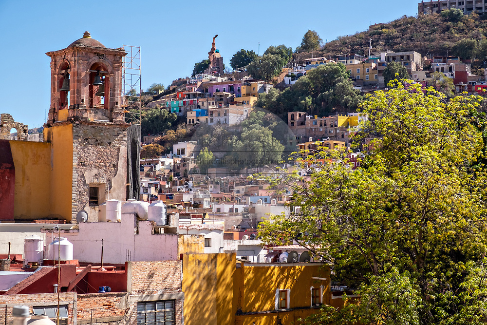 View looking up at the Monument El Pipila on a hilltop park in the historic center of Guanajuato City, Guanajuato, Mexico. The monument honors Juan Jose de los Reyes, a local miner who became an independence hero