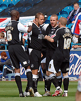 Swansea's Lee Trundle (2nd right) is congratulated on his goal in the first minute.