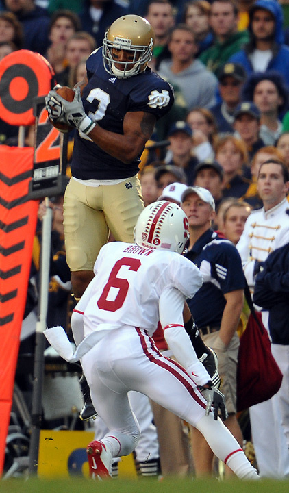 Wide receiver Michael Floyd (3) comes up with the catch over Stanford's Terrence Brown (6)...