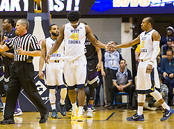 Jan 26, 2016; Morgantown, WV, USA; West Virginia Mountaineers forward Devin Williams (41) and guard Jevon Carter (2) celebrate after a foul was called during the first half against the Kansas State Wildcats at the WVU Coliseum. Mandatory Credit: Ben Queen-USA TODAY Sports