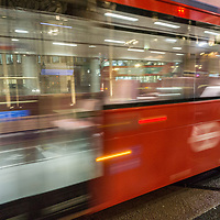 Slow shutter speed of red London bus on the street