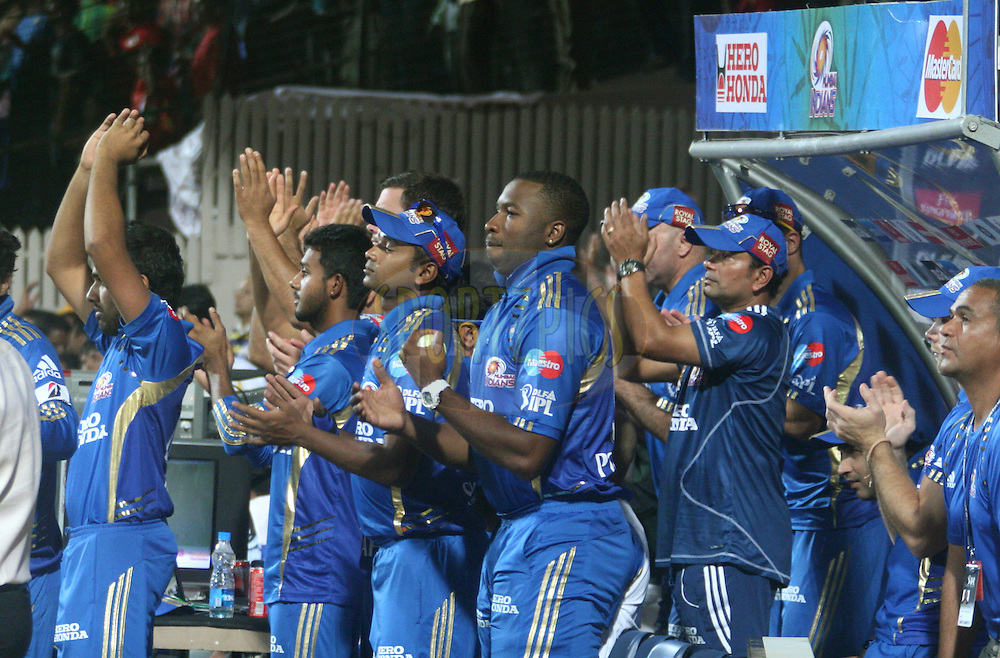 Mumbai Indian players celebrating their win over RCB during match 8 of the the Indian Premier League ( IPL ) Season 4 between the Royal Challengers Bangalore and the Mumbai Indians held at the Chinnaswamy Stadium, Bangalore, Karnataka, India on the 12th April 2011..Photo by Vino John/BCCI/SPORTZPICS