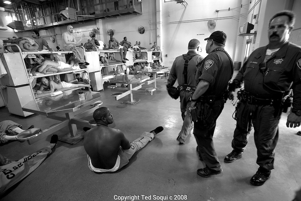 Inmate inside the reception housing unit..California State Prison, Los Angeles County.