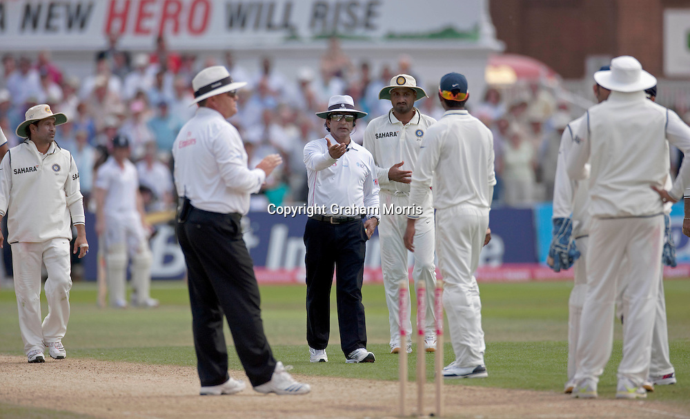 Umpire Asad Rauf tries to sort things out after Ian Bell is run out during the second npower Test Match between England and India at Trent Bridge, Nottingham.  Photo: Graham Morris (Tel: +44(0)20 8969 4192 Email: sales@cricketpix.com) 31/07/11