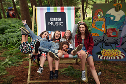 Latitude Festival 2017, Henham Park, Suffolk, UK. Girls on giant BBC deckchair in the woods