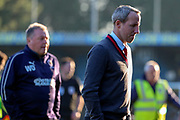 Charlton Athletic manager Lee Bowyer walking off the pitch with AFC Wimbledon manager Wally Downes in the background during the EFL Sky Bet League 1 match between AFC Wimbledon and Charlton Athletic at the Cherry Red Records Stadium, Kingston, England on 23 February 2019.