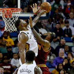 Jan 23, 2017; New Orleans, LA, USA; New Orleans Pelicans forward Terrence Jones (9) blocks a shot by Cleveland Cavaliers forward LeBron James (23) during the fourth quarter of a game at the Smoothie King Center. The Pelicans defeated the Cavaliers 124-122. Mandatory Credit: Derick E. Hingle-USA TODAY Sports