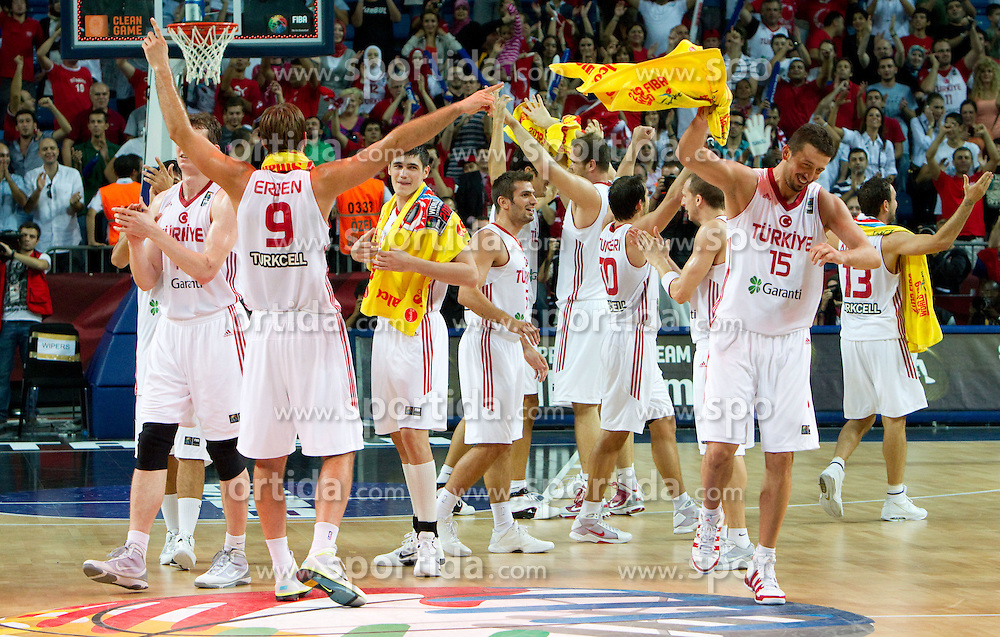 Players of Turkey celebrate after the quarter-final basketball match between National teams of Turkey and Slovenia at 2010 FIBA World Championships on September 8, 2010 at the Sinan Erdem Dome in Istanbul, Turkey.  Turkey defeated Slovenia 95 - 68. (Photo By Vid Ponikvar / Sportida.com)
