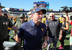 Oct 14, 2017; Morgantown, WV, USA; West Virginia Mountaineers head coach Dana Holgorsen walks off the field after beating the Texas Tech Red Raiders at Milan Puskar Stadium. Mandatory Credit: Ben Queen-USA TODAY Sports