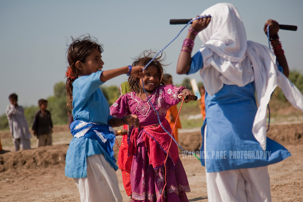 Young girls jump rope at a UNICEF child protective space, on October 6, 2011, in Tando Allahyar, Pakistan. Extreme poverty, poor diet and health, exposure to disease, and inadequate sanitation and hygiene annually produce alarming levels of malnutrition amongst children, but the floods of 2010 and 2011 have increasingly endangered an already vulnerable population. Child malnutrition has breached emergency levels in Pakistan - particularly Sindh province - after monsoon floods devastated the country's poorest region for a second year. Malnourishment It is the single biggest contributor to under-five mortality, increasing the risk of infections and slowing recovery from illness. It stuns both mental and physical growth and their future capacity, sapping the next generation's ability to meet the demands of a country already facing an unstable future. According to UN reports, hundreds of thousands of children in Pakistan suffer from severe-acute-malnutrition, with 15.1% of children experiencing acute malnourishment. The Economist recently reported that 44% of children in Pakistan suffer from varying degrees of malnutrition. (Photo by Warrick Page)