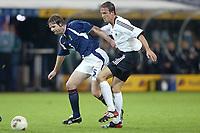 Fotball<br /> EM-kvalifisering<br /> 10.09.2003<br /> Tyskland v Skottland<br /> NORWAY ONLY<br /> Foto: Digitalsport<br /> <br /> FOOTBALL - EURO 2004 - ELIMINATORIES ROUND - GROUP 5 - GERMANY v SCOTLAND - 030910 - STEVEN PRESSLEY (SCO) / FREDI BOBIC (GER) - PHOTO JEAN MARIE HERVIO