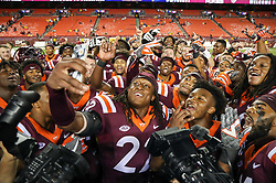 Sep 3, 2017; Landover, MD, USA; Virginia Tech Hokies safety Terrell Edmunds (22) takes a selfie with teammates as they celebrate beating the West Virginia Mountaineers at FedEx Field. Mandatory Credit: Ben Queen-USA TODAY Sports