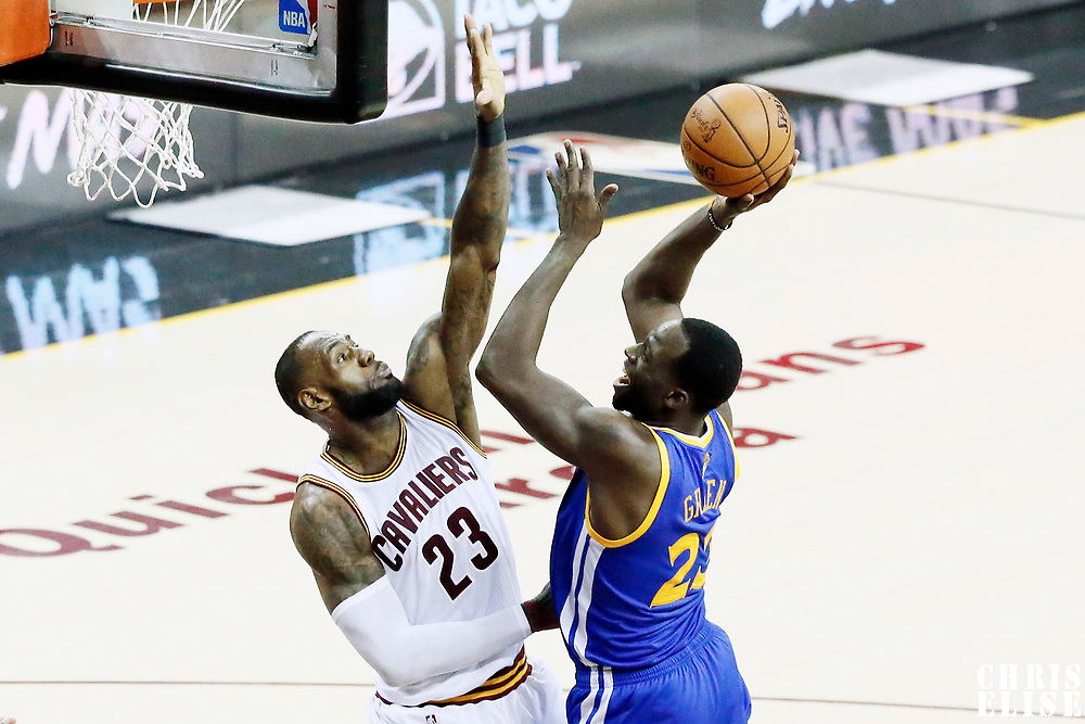 09 June 2017: Golden State Warriors forward Draymond Green (23) goes for the layup against Cleveland Cavaliers forward LeBron James (23) during the Cleveland Cavaliers 137-11 victory over the Golden State Warriors, in game 4 of the 2017 NBA Finals, at  the Quicken Loans Arena, Cleveland, Ohio, USA.