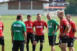 14.07.2013, Walchsee, AUT, FC Augsburg, Trainingslager, im Bild Markus WEINZIERL (Trainer FC Augsburg) mit den Neulingen Arif EKIN (FC Augsburg #31, re. v. Trainer) und Tim RIEDER, Tobias ZELLNER (Co-Trainer FC Augsburg) // during a trainings session of German 1st Bundesliga club FC Augsburg at their training camp in Walchsee, Austria on 2013/07/14. EXPA Pictures &copy; 2013, PhotoCredit: EXPA/ Eibner/ Klaus Rainer Krieger<br /> <br /> ***** ATTENTION - OUT OF GER *****