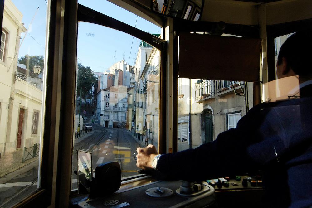 03 JAN 2006, LISBON/PORTUGAL:<br /> Waehrend einer Fahrt mit einer der fast historischen Strassenbahnen durch die alten Stadtteile der Stadt Lissabon<br /> During a ride with the old streetcars through the  historical districts of the city of Lisbon<br /> IMAGE: 20060103-01-004<br /> KEYWORDS: Lisboa, Reise, travel, Europa, europe, Strassenbahn, Stra&szlig;enbahn, Fahrer, driver, Nahverkehr, Bahn, streetcar, tram, tramline