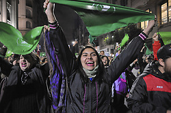 June 13, 2018 - Buenos Aires, Buenos Aires, Argentina - Outside the National Congress, joy and celebration as the Low House debates an abortion law. The bill would pass tightly with 129 votes against 125 and the last word is now in the Senate. Unofficial statistics claim that around 500000 illegal abortions are performed yearly in Argentina, with a number of deaths or severe consequences to the women's health that's difficult to calculate due to the illegality of the abortion and the fear of prosecution of both women and doctors. (Credit Image: © Patricio Murphy via ZUMA Wire)