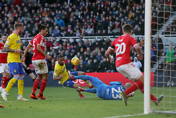 Middlesbrough goalkeeper Darren Randolph stops Leeds United's Kemar Roofe during the Sky Bet Championship match at The Riverside Stadium, Middlesbrough.
