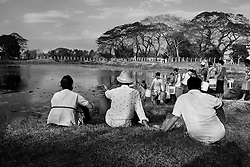 Residents of Dala talking at the edge of the pond during the water gathering. At Dala, Yangon Division, Myanmar, 16th February, 2014.