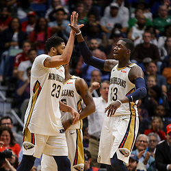 Mar 18, 2018; New Orleans, LA, USA; New Orleans Pelicans forward Anthony Davis (23) celebrates with forward Cheick Diallo (13) during the second half at the Smoothie King Center. Mandatory Credit: Derick E. Hingle-USA TODAY Sports