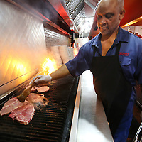 Adam Robison | BUY AT PHOTOS.DJOURNAL.COM<br /> Albert Fears, cook at Bonanza, cooks up customers lunch orders on Wednesday.