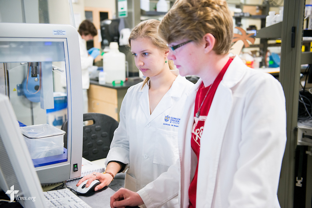 Students Karen Opdahl (center) and Rachel Lange work together in the School of Pharmacy at Concordia University Wisconsin in Mequon, Wis., on Tuesday, May 27, 2014. LCMS Communications/Erik M. Lunsford