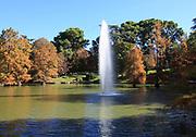 Water fountain in pond lake by Crystal Palace, El Retiro park, Madrid, Spain
