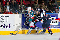 KELOWNA, CANADA - MARCH 4: Parker Wotherspoon #37 of the Tri-City Americans checks Kyle Topping #24 of the Kelowna Rockets into the boards during second period on March 4, 2017 at Prospera Place in Kelowna, British Columbia, Canada.  (Photo by Marissa Baecker/Shoot the Breeze)  *** Local Caption ***