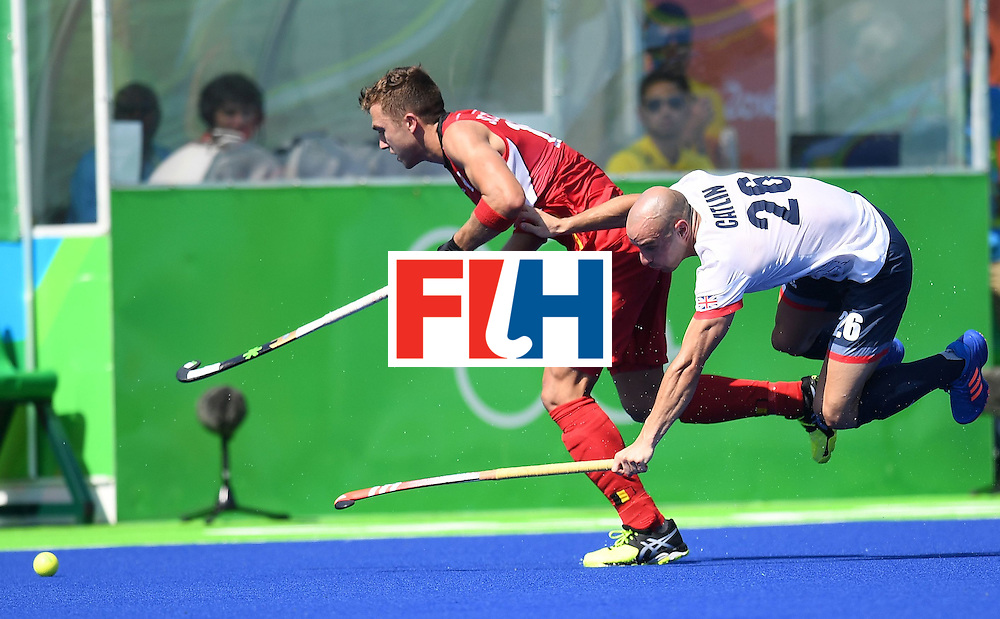 Britain's Nick Catlin (R) fights for the ball Belgium's Emmanuel Stockbroekx during the men's field hockey Belgium vs Britain match of the Rio 2016 Olympics Games at the Olympic Hockey Centre in Rio de Janeiro on August, 6 2016. / AFP / MANAN VATSYAYANA        (Photo credit should read MANAN VATSYAYANA/AFP/Getty Images)