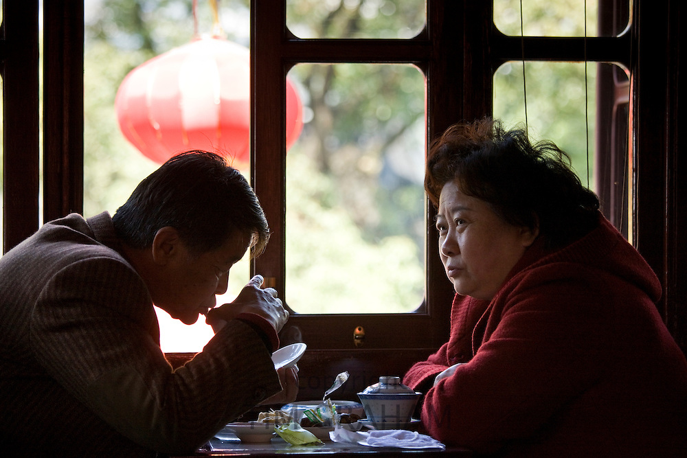 Couple drinking tea in the Huxinting Teahouse, Yu Garden Bazaar Market, Shanghai, China