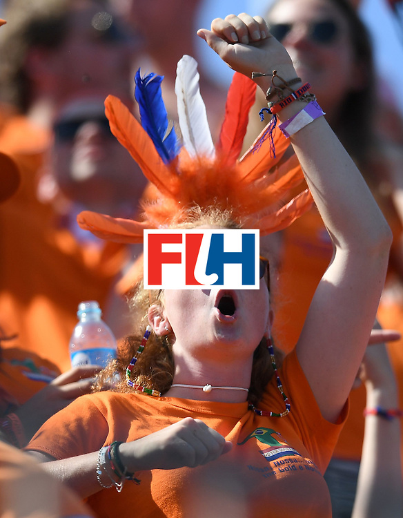 A Netherland's fan cheers during the men's field hockey Argentina vs Netherlands match of the Rio 2016 Olympics Games at the Olympic Hockey Centre in Rio de Janeiro on August, 6 2016. / AFP / MANAN VATSYAYANA        (Photo credit should read MANAN VATSYAYANA/AFP/Getty Images)