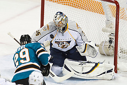 January 8, 2011; San Jose, CA, USA;  Nashville Predators goalie Pekka Rinne (35) stops a shot from San Jose Sharks right wing Ryane Clowe (29) during the first period at HP Pavilion. Mandatory Credit: Jason O. Watson / US PRESSWIRE