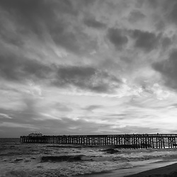 Balboa Pier dramatic cloudy sky in Newport Beach California. Newport Beach is a popular coastal beach city along the Pacific Ocean in Orange County Southern California. Copyright ⓒ 2017 Paul Velgos with All Rights Reserved.