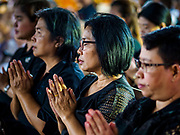 25 OCTOBER 2017 - BANGKOK, THAILAND: Women pray for the late King during the funeral for Bhumibol Adulyadej, the Late King of Thailand. He died in October 2016 and was cremated during an ornate five day funeral on 26 October 2017. He reigned for 70 years and was Thailand's longest serving monarch.         PHOTO BY JACK KURTZ