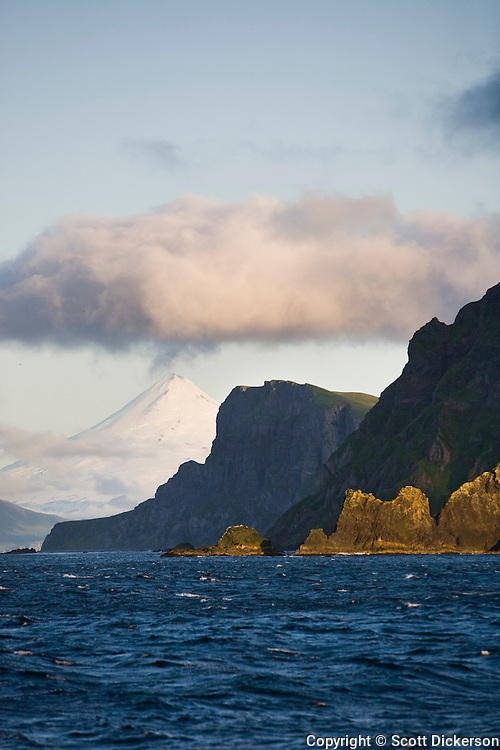 Shishaldin Volcano and rugged cliff shoreline on Unimak Island, Eastern Aleutian Islands, Alaska