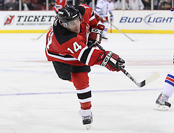 Nov 5, 2010; Newark, NJ, USA;  New Jersey Devils center Stephen Gionta (14) takes a shot during the third period of their game against the New Jersey Devils at the Prudential Center. The Rangers defeated the Devils 3-0.