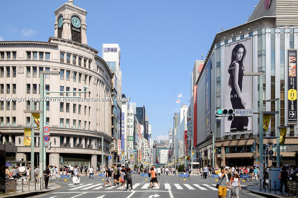 Busy street in upmarket shopping district of Ginza in Tokyo Japan
