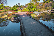 "Stone Bridge at Ninomaru Imperial Palace East Gardens -made up of the Honmaru and Ninomaru areas of Edo Castle.  None of the Edo Castle buildings remain today, though the moats, walls, gates and guardhouses still exist.  Honmaru is the most spacious area of the garden and visitors can view cherry trees, roses, bamboo and a tea garden.  Ninomaru Garden is planted with 260 trees donated by each prefecture of Japan surrounding a pond.  In 1963 the garden was declared by the Japanese government a ""Special Historic Relic"" under Cultural Properties Protection."