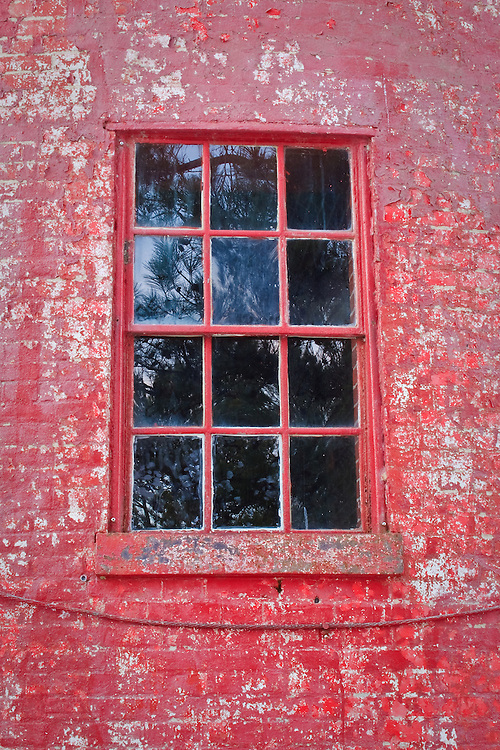 Window in the turret of the Assateague Lighthouse (rebuilt 1866) with weathered paint, Chincoteague National Wildlife Refuge, Assateague Island, Virginia.
