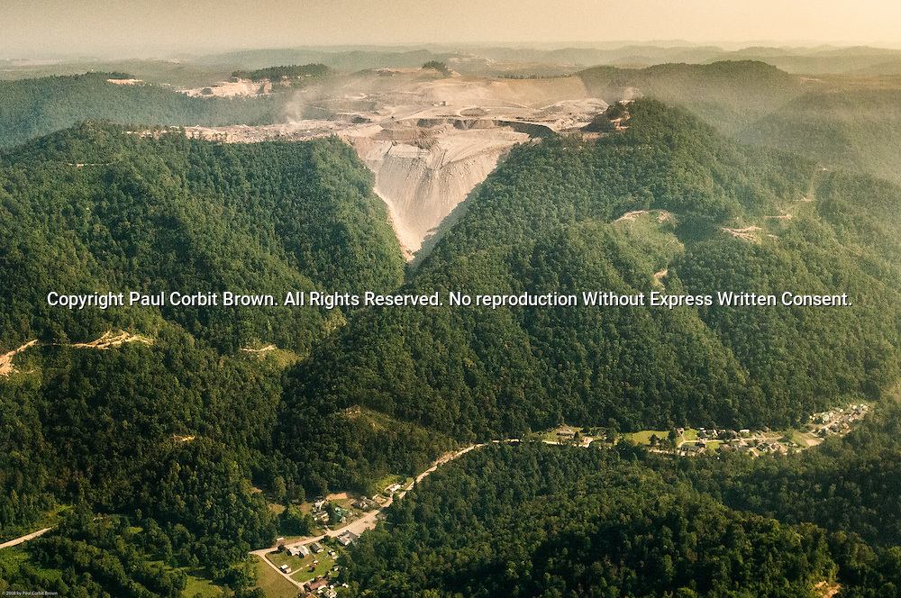 September 3, 2008. Valley Fill at Kayford Mountain. A cloud of dust moves off the mine site to settle on the community of Dorthy, WV. Recent scientific studies suggest the dust from MTR sites causes significant health problems for people in the surrounding areas.