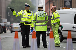 "© Licensed to London News Pictures . 03/10/2015 . Manchester , UK . A "" ring of steel "" and police on the roads around the Manchester Central Convention Centre where the Conservative Party are holding their annual conference . Photo credit: Joel Goodman/LNP"