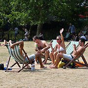 People sunbathing in hot weather at Green Park, London, UK on July 1st 2018.