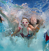 Children make their way across the pool at the Roseville Aquatics Complex. More than 80 kids were at the facility, which is the only facility in Northern California participating with aquatic facilities around the globe tomorrow for The World?s Largest Swimming Lesson. June 14, 2011.