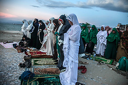 October 5, 2018 - Palu, Central Sulawesi, Indonesia - Indonesian Muslims offer prayers near a beach Talise which was swept ashore by the tsunami, in Palu on October 5, 2018, Central Sulawesi, Indonesia, after the September 28 earthquake and tsunami. Search teams made desperate last-ditch efforts on October 5 to find survivors in destroyed buildings a week on from Indonesia's devastating quake-tsunami, have counted 1,558 dead from the double disaster on Sulawesi island, while 2,549 people are seriously injured. (Credit Image: © Ivan Damanik/ZUMA Wire)