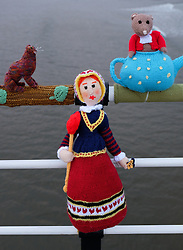 © Licensed to London News Pictures.<br /> 22/05/15<br /> <br /> Saltburn, UK. <br /> <br /> The Saltburn Yarn Bombers strike again in the early hours of the morning as they attach their latest creations to the railings on the pier at the beach. The knitted figures that represent, on the year marking the 150th anniversary, characters from Lewis Carroll's classic children's book Alice's Adventures in Wonderland are the latest creations from this group whose identities still remain a mystery.<br /> <br /> Photo credit : Ian Forsyth/LNP