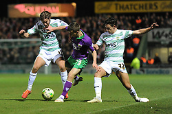 Bristol City's Joe Bryan challenges for the ball with Yeovil Town's Sam Foley and Yeovil Town's Liam Shepard - Photo mandatory by-line: Dougie Allward/JMP - Mobile: 07966 386802 - 10/03/2015 - SPORT - Football - Yeovil - Huish Park - Yeovil Town v Bristol City - Sky Bet League One